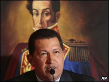 President Hugo Chavez, in front of a portrait of Simon Bolivar