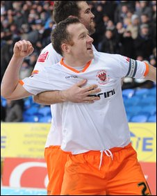 Charlie Adam celebrates after drawing Blackpool level at Cardiff City