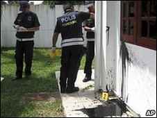 Police inspect black paint thrown at a church in Malacca state.