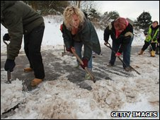 Villagers clear snow to the local school in Radstock