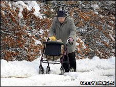 A pensioner struggles to the shops
