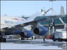 A plane is de-iced at Stansted Airport in Essex