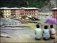Villagers in Bhutan looking at the aftermath of a landslide (Image: AP)