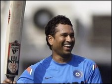 Indian cricketer Sachin Tendulkar laughs during a practice session in Mumbai, India, Tuesday, Dec. 1, 2009
