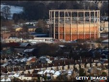 Snow has settled on houses surrounding this gasometer in  Bath