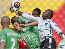 Malawi goalkeeper Swadick Sanudi punches a cross by Algeria