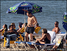 Sunbathers in Tel Aviv, at the same time as the UK's cold snap