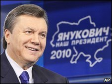 Viktor Yanukovych in front of a sign reading 'Yanukovych is our president', file pic from December 2009