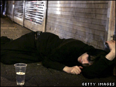 A man lies on a pavement after a night out