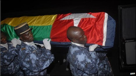 The coffin of one of those killed arriving back in Togo