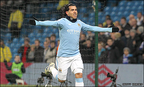 Carlos Tevez celebrates scoring City's opener