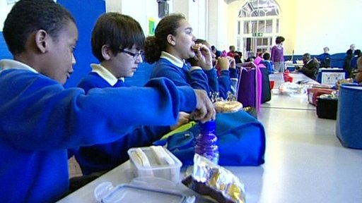 Children eat packed lunch