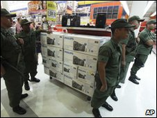 Soldiers seize a shop, accused of raising prices, in Caracas