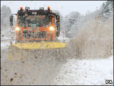 Snow plough throws up grit-laden slush