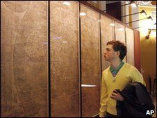 A visitor studies Matteo Ricci's 400-year-old world map at the Library of Congress