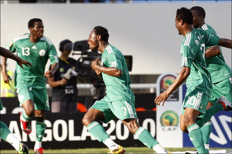 Nigeria's Chinedu Obasi, centre, celebrates after scoring a goal during their African Cup of Nations Group C football match against Egypt