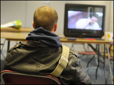 A 26-year-old from Latvia watching TV in the shelter