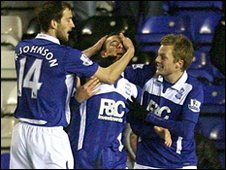 Barry Ferguson (centre) is congratulated after scoring