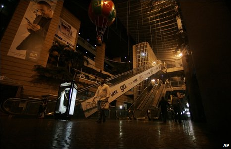 A shopping mall in Caracas with dimmed lights to conserve power, 5 January