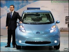 Nissan chief Carlos Ghosn with the all-electric Leaf