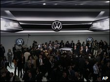 Volkswagen's petrol-electric hybrid concept beams down at journalists at the Detroit auto show