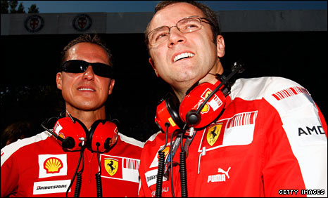 Michael Schumacher and Ferrari team boss Stefano Domenicali