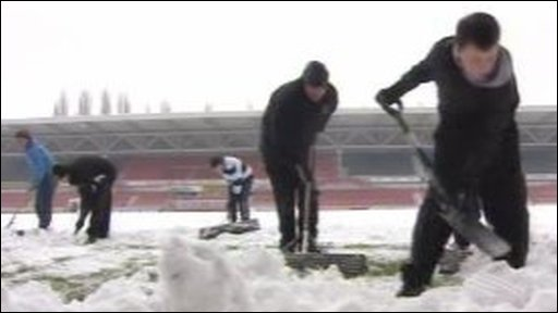 Wrexham FC supporters shoveling snow