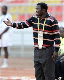 Malawi's coach Kinnah Phiri gives instructions to his players
