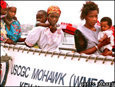 Haitians disembark the Coast Guard cutter Mohawk, 22 April 1994,