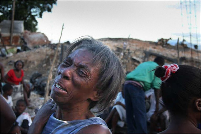 A woman cries amid devastation in Port-au-Prince