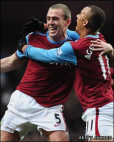 Richard Dunne (left) celebrates a goal with Aston Villa team-mate Gabriel Agbonlahor