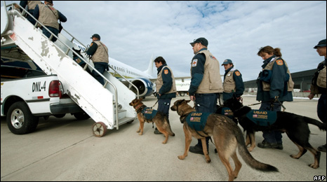 Search-and-rescue teams board a plane in the US