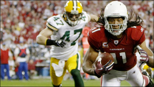 Arizona Cardinals' Larry Fitzgerald scores against the Green Bay Packers