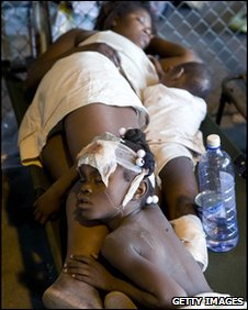 Haitian children sleep with their mother at a UN hospital in Port-au-Prince, evening of 13 January