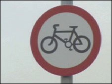 There are signs at Britannia Bridge asking cyclists to dismount