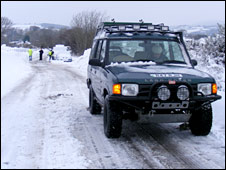 A 4x4 in the snow