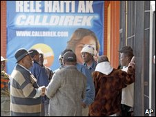 A group of men wait anxiously for news in the Little Haiti district of Miami
