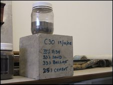 Concrete made from sludge ash