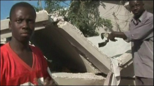 Haitians look through rubble