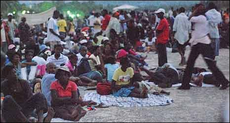 People in a camp at an airport in Haiti