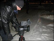 Reporter David Allison filming in Norway
