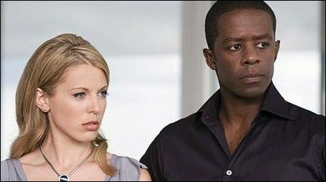 Kelly Adams and Adrian Lester
