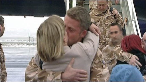 Returning airman being embraced