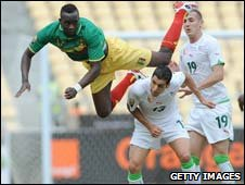 Mali's Momo Sissoko (in green) dives for a header