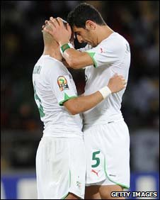 Algeria's Rafik Hallice (right)