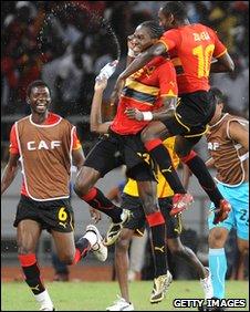 Angolan players celebrate