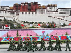 Soldiers patrol the plaza in front of the Potala in Lhasa, former palace of the Dalai Lama - 21 June 2008