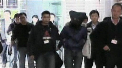 Acid attack suspect being led by police
