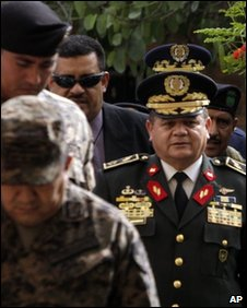 General Romeo Vasquez (with medals) and other military chiefs appear at the Supreme Court on 14 January