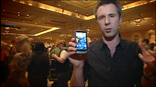 Spencer Kelly holding the Nexus One phone